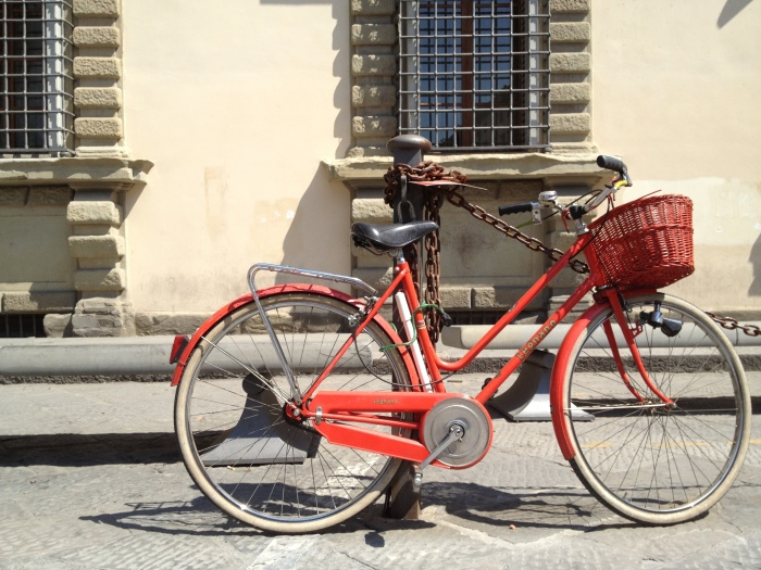 Red bicycle in Florence, Italy via MontgomeryFest