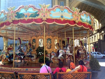 Colorful carousel in Florence, Italy via MontgomeryFest